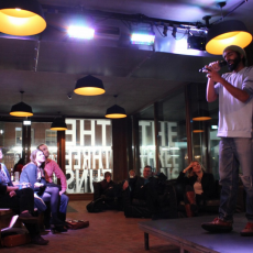Zia Ahmed performing at Rhyme and Reason, during Climate Week 2014, at the London School of Economics.